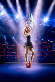 Boxing ring girl  is holding the number poster