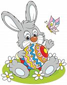 picture of cony  - Little rabbit sitting with a big decorated Easter egg - JPG