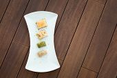 picture of baklava  - Variety of turkish baklava on a white porcelain plate - JPG