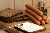 Sausage, Also Known As Knackwurst On A Timber Board poster