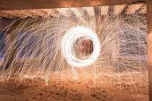 image of slag  - Showers of hot glowing sparks from spinning steel wool at Coney Island Beach Brooklyn New York - JPG
