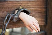 stock photo of slavery  - Hand in chains  - JPG