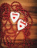 picture of two hearts  - Two hearts on wooden board Valentines Day - JPG