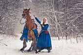 pic of horse face  - Young woman wearing medieval clothes and her horse - JPG