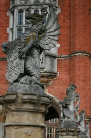 stock photo of entryway  - Statuary at the entryway to Hampton Court - JPG