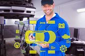 picture of handyman  - Handyman in blue overall writing on clipboard against auto repair shop - JPG