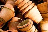 stock photo of flower pot  - Clay flower pots lying in stacks - JPG