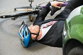 pic of accident victim  - Unconscious Male Cyclist Lying On Street After Road Accident - JPG
