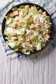 foto of caesar salad  - Traditional Caesar salad with croutons and parmesan on a plate - JPG