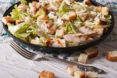 foto of caesar salad  - Delicious Caesar salad with grilled chicken breast close - JPG