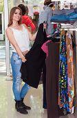 pic of wardrobe  - Beautiful teenage girl looking wardrobe in a boutique - JPG