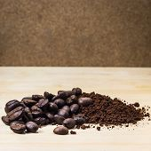 picture of coffee grounds  - roasted coffee beans and ground coffee on Wood - JPG