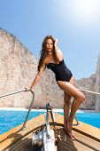 picture of shipwreck  - Woman sailing at shipwreck navagio beach in Zakynthos Greece - JPG