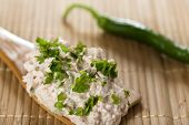 picture of canard  - Liver pate with hot pepper and parsley on a wooden spoon with parsley - JPG