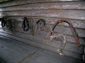 picture of harness  - Traditional Russian wooden shaft bows and other horse harness in the farmhouse - JPG