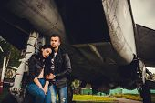 picture of hug  - Stylish Couple hugging near the aircraft - JPG