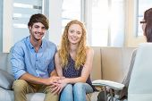 foto of psychologist  - Psychologist and happy couple in the office - JPG