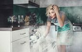 picture of vapor  - Creative photo of a astonished woman cook frying lunch in a oven - JPG