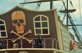 stock photo of skull crossbones flag  - The photo shows a fragment of the stern of a yacht with the image of a pirate symbols - JPG
