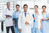 pic of medical office  - Portrait of confident doctors with arms crossed at medical office - JPG