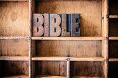 foto of bible verses  - The word BIBLE written in vintage wooden letterpress type in a wooden type drawer - JPG