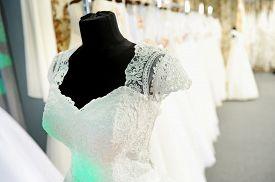 stock photo of dress mannequin  - Beautiful wedding dress on a mannequin at a wedding fair - JPG
