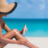 Beach body suntan skin care travel vacation. Bikini hat woman applying sunscreen lotion putting crea poster