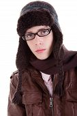 Young Boy Looking Serious, With Winter Clothes, Glasses And Hat, Isolated On White, Studio Shot