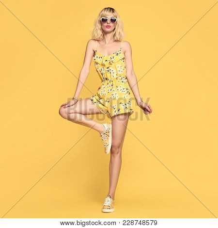 poster of Fashionable Female Blond Model, Trendy Sunglasses. Stylish Glamour Summer Yellow Fashion Outfit. You