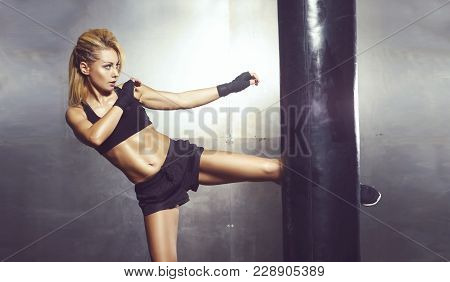 poster of Fit And Sporty Young Woman Having A Muay Thai Training. Girl Training In Undergorund Gym. Health, Sp