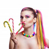 Portrait Of A Young Girl With Colorful Creative Makeup And Colored Strands Of Hair. The Woman Holds poster
