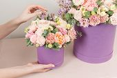 Perfect Gift Or Compliment. Bouquet In Green Hatbox. Beautiful Luxury Bunch Of Mixed Flowers In Woma poster