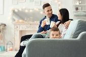 Happy family spending time together on winter vacation at home poster