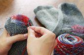 darning socks, repairing holes in socks poster