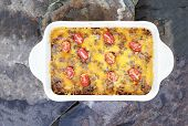 picture of hash  - Hash Brown Strata or Breakfast Casserole made with a crust of hash browns eggs sausage and cheddar cheese - JPG
