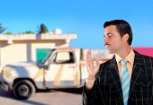 car used salesperson selling old car as brand new  typical topic salesman with hand ok gesture [Phot
