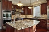pic of granite  - Kitchen with granite island and cherry wood cabinetry - JPG