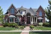 stock photo of turret arch  - Brick home with turret and arched entry - JPG