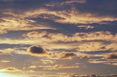 Sunset Cloudy Sky With Clouds Lit By Sunlight - Natural Sky Background. Sunset Sky Background.dramat poster