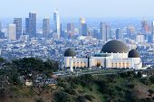 Griffith Observatory Park With Los Angeles Skyline At Dusk. Twilight Views Of The Famous Monument An poster
