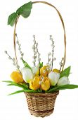 picture of flower arrangement  - arrangement of artificial flowers and willows in braided basket isolated on white background - JPG