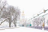Entrance Gate Of The Pechersk Lavra In Kiev, Ukraine. The Gate Church Of The Trinity In Winter Snow  poster