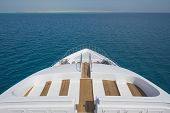 Rear Teak Deck Of A Large Luxury Motor Yacht With Chairs Sofa Table And Tropical Sea View Background poster