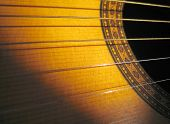 stock photo of acoustic guitar  - acoustic guitar with shadow - JPG