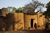 stock photo of mud-hut  - a traditional mud house in a west african village - JPG