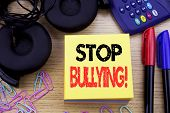 Word, Writing Stop Bullying. Business Concept For Prevention Problem Bully Written On Sticky Note Pa poster