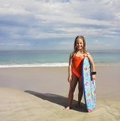 pic of boogie board  - Portrait of girl holding boogie board at beach - JPG