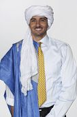 stock photo of traditional attire  - Middle Eastern man wearing traditional dress and business attire - JPG