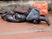 foto of tramp  - Homeless man sleeps on a pavement - JPG