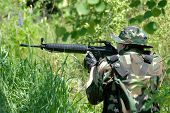 pic of hider  - The soldier in protective clothes with weapon - JPG